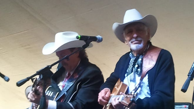 Dave Alexander (L) and Tommy Allsup (R) playing music together on the Ray Reed stage.