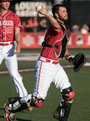 Ragin' Cajuns senior catcher Nick Thurman throws to first after fielding a squibber as UL beats Texas State 5-4 in a Friday-night game last month.