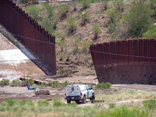 A section of the border fence being repaired