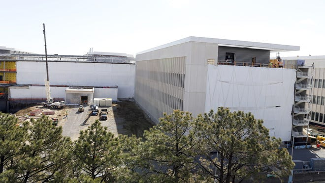Workers toil to build the Veterans Affairs hospital Wednesday, April 15, 2015, in Aurora, Colo.