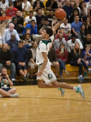 Runner up - Lonzo Ball of Chino Hills High School in Chino Hills, CA performs during the City of Palms Classic slam dunk contest on Sunday, December 20, 2015.  Photo by Gregg Pachkowski