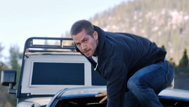 Brian (Paul Walker) goes to great lengths to take down Deckard Shaw (Jason Statham) and his minions in 'Furious 7.'