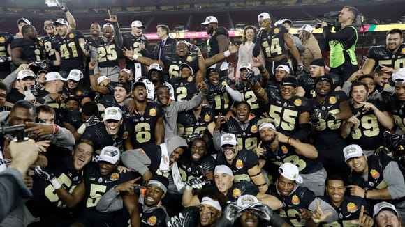 Purdue players celebrate after a 38-35 win over Arizona during the Foster Farms Bowl NCAA college football game Wednesday, Dec. 27, 2017, in Santa Clara, Calif. (AP Photo/Marcio Jose Sanchez)