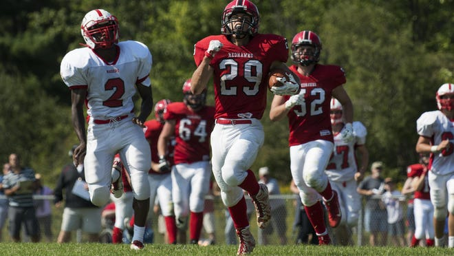 CVU's Braven Bose (29) runs for a touchdown in the season-opening win over Rutland.