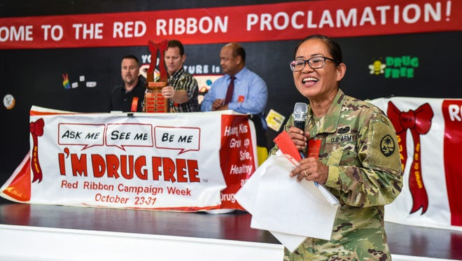 """Sgt. 1st Class Corina Andre, front, with the Guam National Guard's Counterdrug Program, addresses the students during a Red Ribbon event at Upi Elementary School in Yigo on Tuesday, Sept. 26, 2017. The theme for this year's campaign is """"Your Future Is Key, So Stay Drug Free."""""""