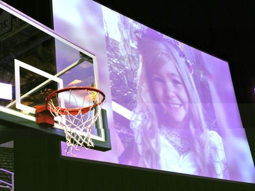 A memorial service for Lacey Holsworth, an eight-year-old Michigan State basketball fan whose battle with cancer inspired the team's players and coaches, was held at Michigan State University's Breslin Center on Apr. 17, 2014.