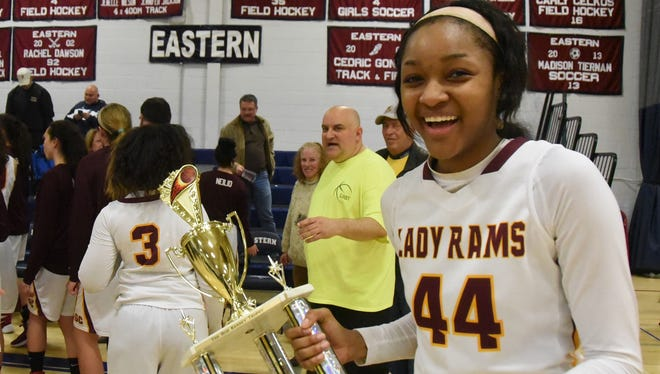Gloucester Catholic's Danielle Sanderlin holds the championship trophy of  the South Jersey Invitational Basketball Tournament after the Rams defeated Cherokee in Sunday's final.