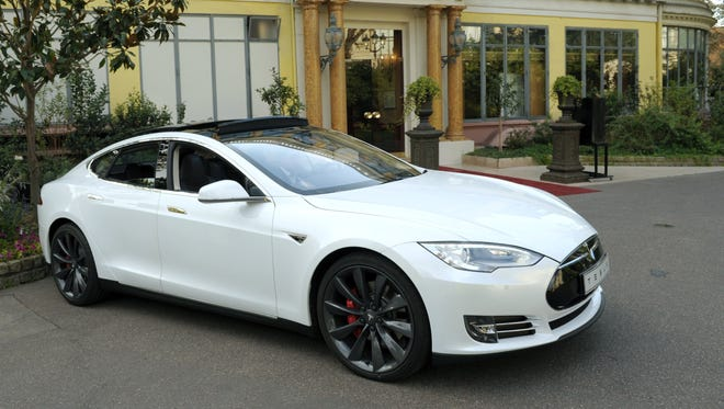 Tesla suffers a setback as Michigan bans direct car sales and Tesla galleries in state.