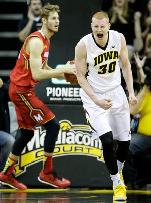Iowa forward Aaron White reacts after dunking in the first half. The Hawkeyes were up 40-17 on No. 17 Maryland at the break.