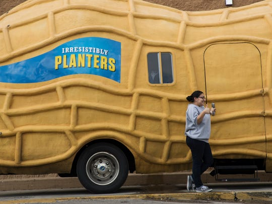 Rebecca Vera takes a picture with the  Planters Nut Mobile at the Wal-Mart on Lee Boulevard in Lehigh Acres on Thursday. A crew of peanutters are taking one of three mobile billboards throughout the east. They were giving away peanuts and good cheer.