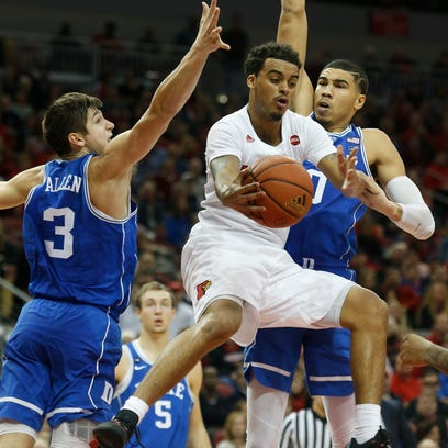 Louisville's Quentin Snider splits defenders for an
