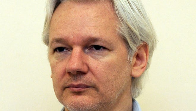 Wikileaks founder Julian Assange speaks to the media inside the Ecuadorian Embassy in London on June 8, 2013.