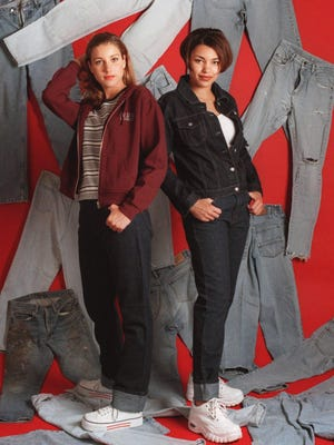 In this file photo, dark denim jeans in boot cut and original straight legs are paired with layers including tank tops and denim and zipper sweat jackets, all from the Gap. Some jeans include rips in the knees.