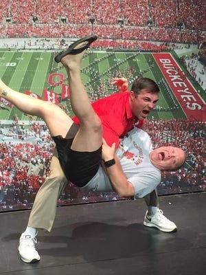 Anthony Schlegel tackles cruise passenger Mitch Price.