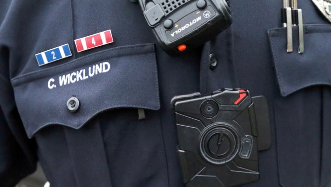 Police body cameras, as pictured on an officer in Minnesota in this file photo, are the focus of a lawsuit by the Riverside Sheriff's Association.