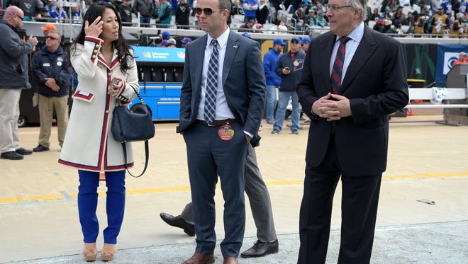 Buffalo Bills owners Kim Pegula, left, and Terry Pegula, right, watch warmups with general manager Brandon Beane before an NFL wild-card playoff football game against the Jacksonville Jaguars Sunday, Jan. 7, 2018, in Jacksonville, Florida.