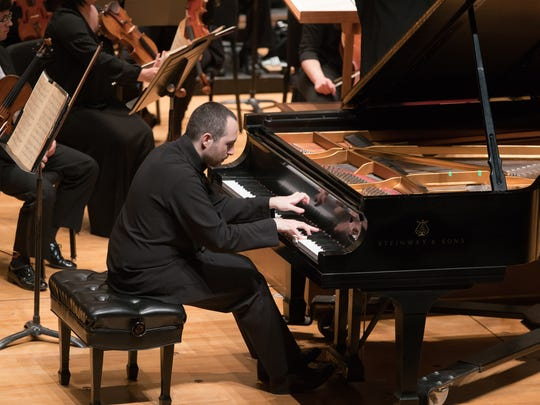 Antonio Pompa-Baldi performing with the Evansville Philharmonic Orchestra in January 2016.