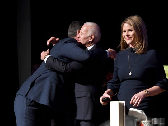 Fran Person hugs former vice president Joe Biden as he and moderator Jenna Bush Hager take the stage for the Joe Biden: American Promise Tour at the U.S. Cellular Center on Thursday, Dec. 14, 2017. Asheville is the final stop in the national book tour.