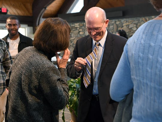 "John Anthony ""Tony"" Floyd shows off his tie given to him by outgoing president Dan G. Lunsford as he meets members of the crowd after being announced as the new president of Mars Hill University during a ceremony at the Broyhill Chapel on campus on Friday, March 9, 2018. Floyd will replace Lunsford following his retirement starting on June 1 as the sixth president of the university since 1897."