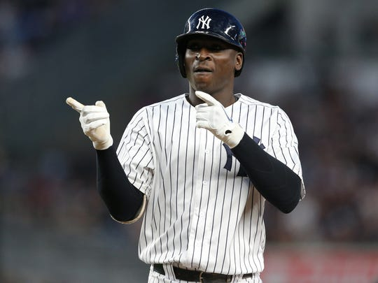 Jul 31, 2018; Bronx, NY, USA; New York Yankees shortstop Didi Gregorius (18) reacts after hitting an RBI single against the Baltimore Orioles during the third inning at Yankee Stadium.