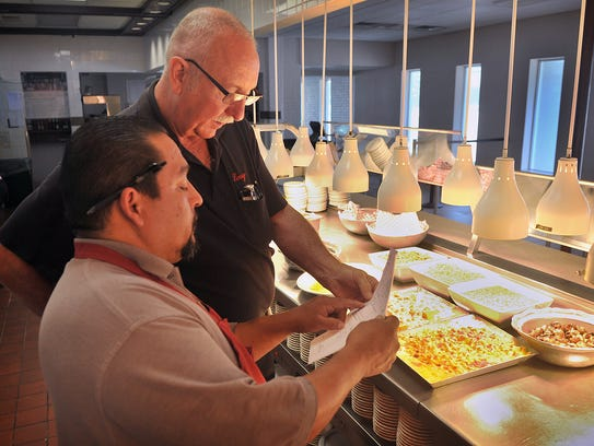 Luby's general manager Larry Ahlhorn, right, answers
