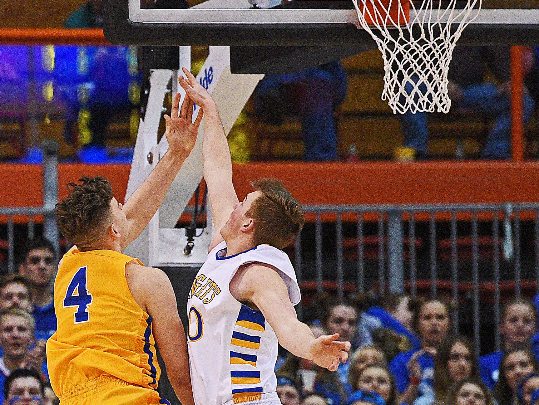 Aberdeen Central's Christian Goetz (4) goes up for a shot as O'Gorman's Jaron Zwagerman (40) defends during the 2017 SDHSAA Class AA State Boys Basketball championship game Saturday, March 18, 2017, at Rushmore Plaza Civic Center in Rapid City.