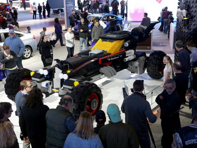 People start to crowd around the Lego Batmobile nicknamed