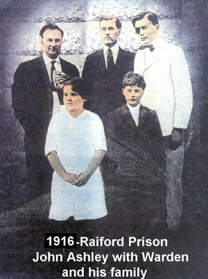 The welcome entrance at Raiford Prison on Nov. 23, 1916, for outlaw John Ashley (far right), posing with the Superintendent D.W. Purvis, (next to Ashley), along with another prison official and Purvis' children.