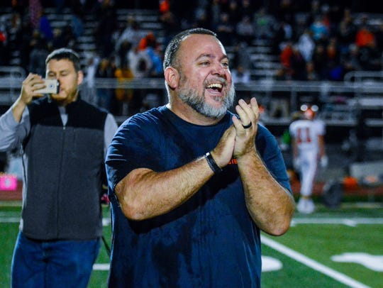 York High head coach Russ Stoner celebrates during last season's 26-19 victory over Central York. The two teams will face off Friday at Small Field. John A. Pavoncello photo