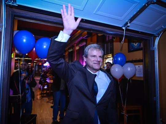 Michael Helfrich arrives after the polls closed at Holy Hound to a room crowded with supporters, Tuesday, Nov. 7, 2017. John A. Pavoncello photo