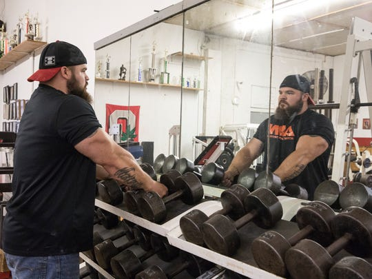 Brandon Conley gets ready to lift weights at the Sweat Shop, a gym he frequently works out at in Chillicothe.