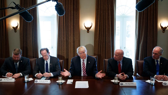 President Donald Trump speaks during a meeting with lawmakers about trade policy in the Cabinet Room of the White House, on Feb. 13, 2018, in Washington. From left, Rep. Rick Crawford, R-Ariz., Sen. Pat Toomey, R-Pa., Trump, Rep. Kevin Brady, R-Texas, and Sen. Bob Casey, D-Pa.