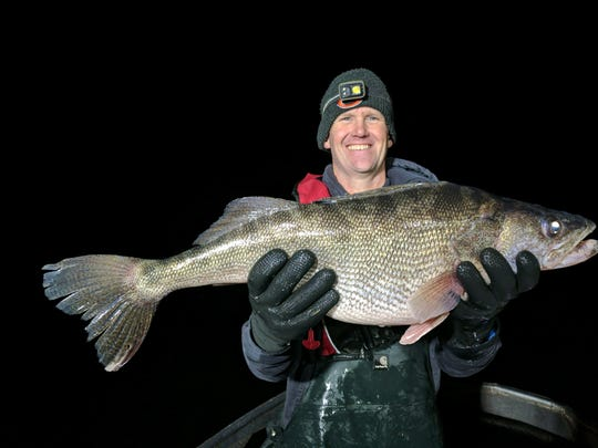 Jason Euchner of the Iowa Department of Natural Resources poses for a photo holding a 30-inch, 13.4-pound walleye at Big Creek Lake.