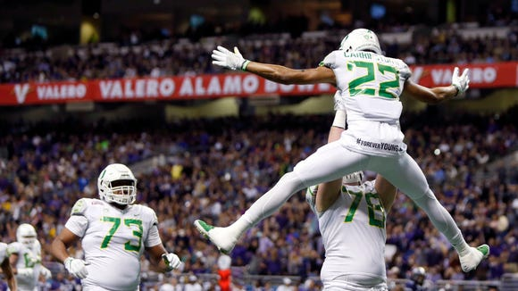 Jan 2, 2016; San Antonio, TX, USA; Oregon Ducks wide receiver Darren Carrington (22) and right guard Cameron Hunt (78) celebrate a touchdown pass reception against the TCU Horned Frogs in the 2016 Alamo Bowl at the Alamodome. Mandatory Credit: Erich Schlegel-USA TODAY Sports
