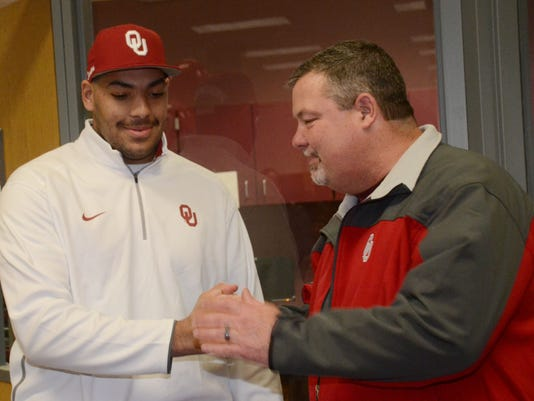 ANI Cody Ford Oklahoma Pineville High School student and football player Cody Ford (left) is congratulated by Pineville football coach Robbie Martin after Ford signed with Oklahoma Wednesday, Feb. 4, 2015.-Melinda Martinez/mmartinez@thetowntalk.com The Tow