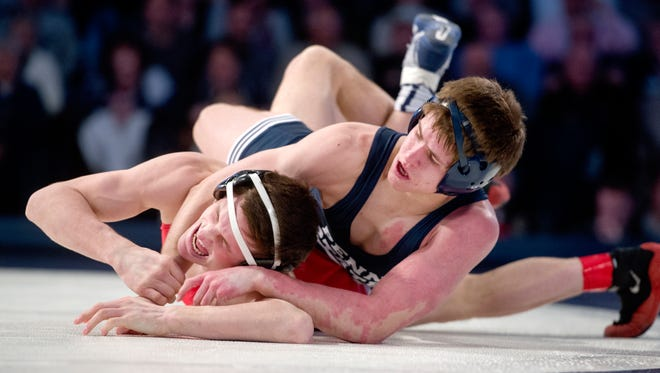 Penn State's Jordan Conaway, right, took fourth at 133 pounds on Sunday at the Big Ten Wrestling Championships.