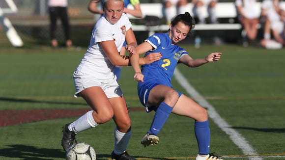 From left, Arlington's Kendall Feighan and Mahopac's Christina Lopreato battle for ball control at Arlington High School in Freedom Plains on Tuesday. Arlington won the game 3-0.