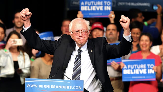 Democratic presidential candidate Sen. Bernie Sanders acknowledges his supporters during a campaign event in Miami Tuesday night. (Pedro Portal/El Nuevo Herald/TNS)