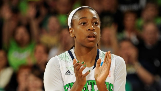 Notre Dame guard Jewell Loyd applauds her team's effort during a time out in the first half of their NCAA women's college basketball tournament regional final game at the Purcell Pavilion in South Bend, Ind Monday March 31, 2014.