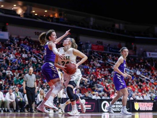 Iowa City West junior Emma Koch drives the lane as