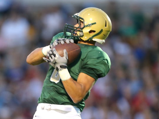 Iowa City West Trojans Oliver Martin catches a touchdown pass on Friday night against the Southeast Polk Rams.
