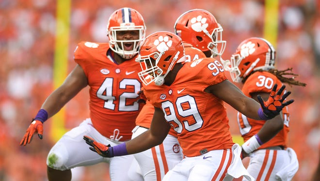 Clemson defensive lineman Clelin Ferrell (99) reacts after sacking SC State quarterback Caleb York (12) during the 1st quarter on Saturday, September 17, 2016 at Clemson's Memorial Stadium.