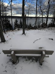 A bench invites winter enthusiasts at Peninsula State Park to take in the view of Eagle Harbor at Ephraim.