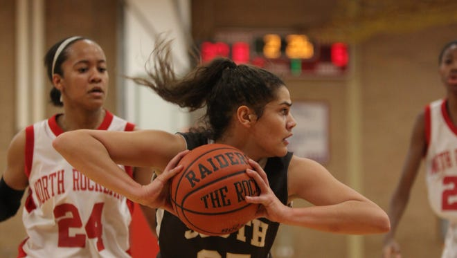 Clarkstown South's Laura Castaldo (25) catches a rebound  in game action against North Rockland  in Thiells Jan. 17, 2014.