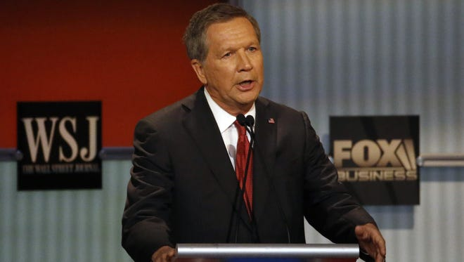 John Kasich speaks during Republican presidential debate at Milwaukee Theatre, Tuesday night.