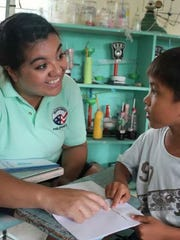 Sarina Ufi, a Little Chute native, reads with a student