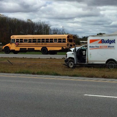 A rental van and school bus were among the vehicles