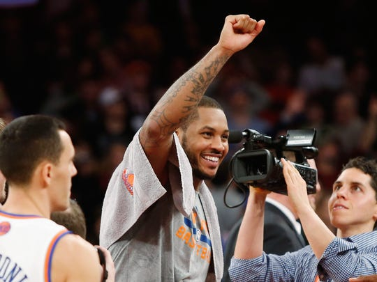 Jan. 24, 2014: Carmelo Anthony was all smiles after he delighted the home crowd and lit up Madison Square Garden with a franchise and arena-record 62 points in the Knicks' 125-96 win over the Bobcats.
