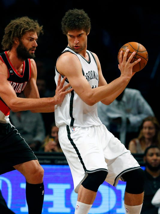 Nets top Blazers to tighten grip on seventh place