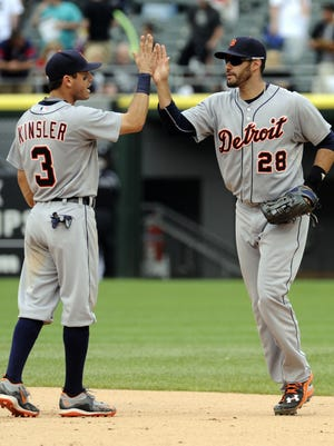 Detroit Tigers second baseman Ian Kinsler (3) and rightfielder J.D. Martinez celebrate defeating the Chicago White Sox on June 7,  2015.
